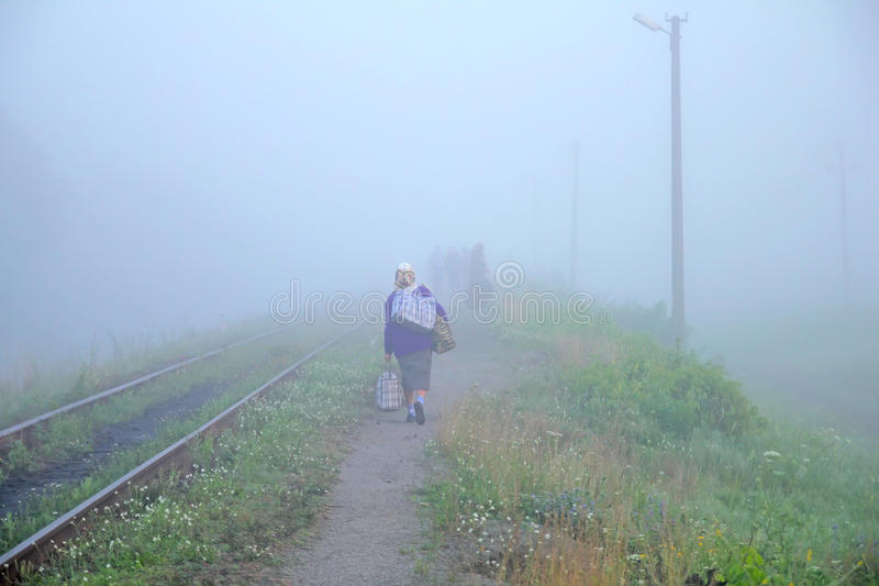 Scene of old woman - the female bogey in the mist. Scene of an old woman - the female bogey in the mist stock images