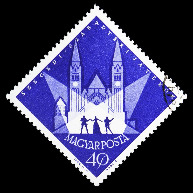 Scene of an outdoor play in front of Votiv Church, Summer Festival, Szeged serie, circa 1963. MOSCOW, RUSSIA - MAY 25, 2019: Postage stamp printed in Hungary royalty free stock photos