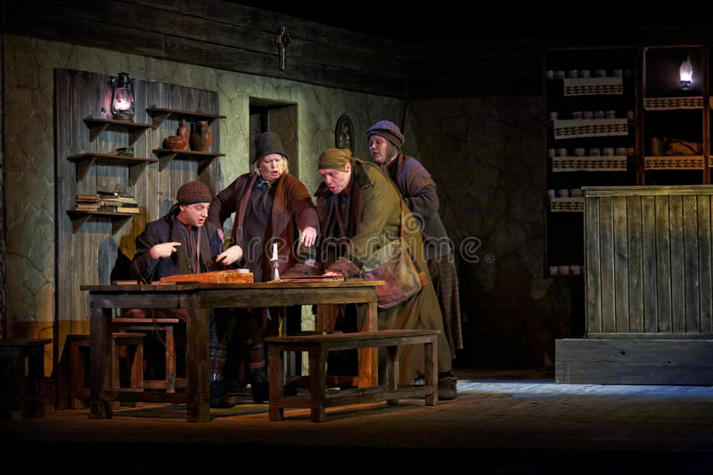 Scene from play The Cripple from Inishmaan. MOSCOW - JAN 18: Scene from play The Cripple from Inishmaan at Theatre on Taganka, Jan 18, 2012, Moscow, Russia. This stock image