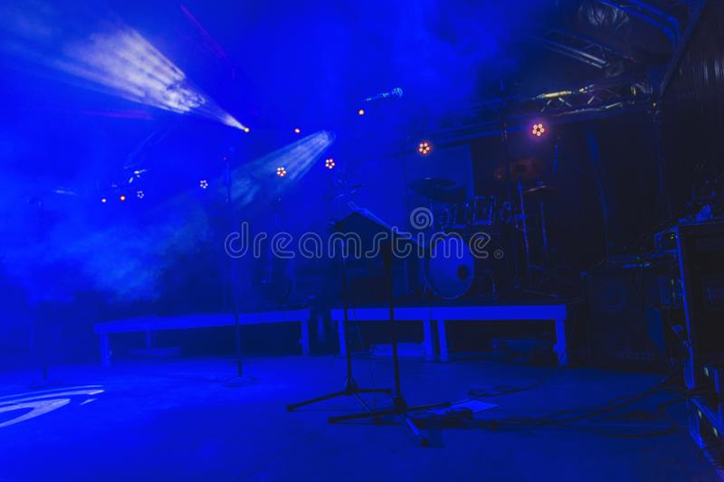 A scene during a rock concert, with musical instruments and stage lights, a rock performance show, after a performance, without pe. Ople stock image