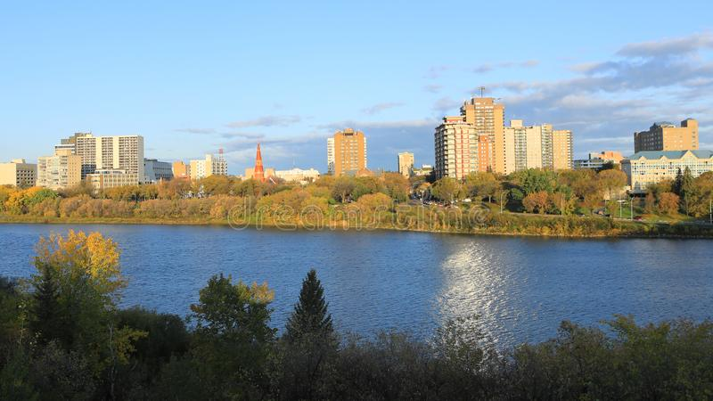 Scene of Saskatoon, Canada skyline by river. A Scene of Saskatoon, Canada skyline by river royalty free stock image