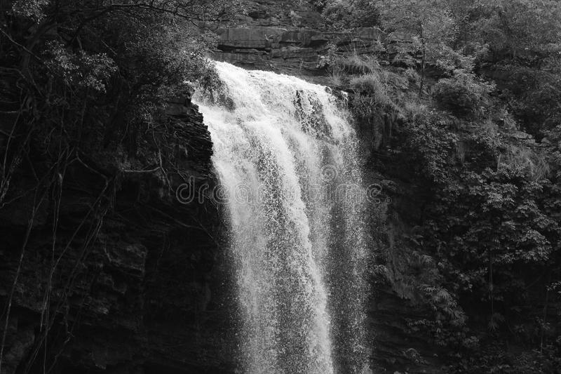 Scene of Second Stage of Tirathgarh Waterfall. Beautiful scenario of Tirathgarh Waterfall at it`s second stage in black & white royalty free stock photos