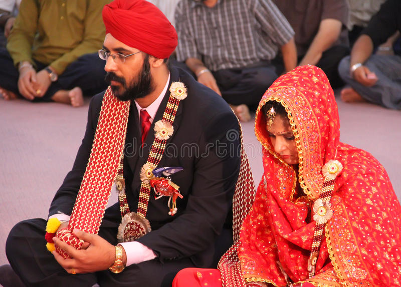 Scene at a Sikh Wedding. The bride and groom at a sikh wedding in Malaysia stock images