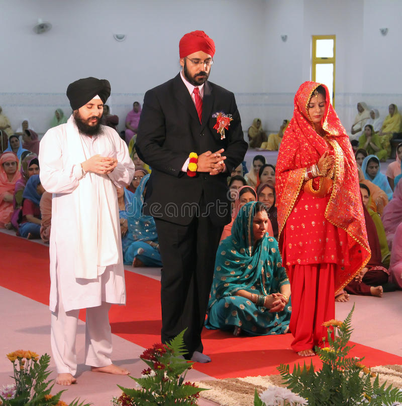 Scene at a Sikh Wedding. The bride and groom at a sikh wedding in Malaysia stock photo