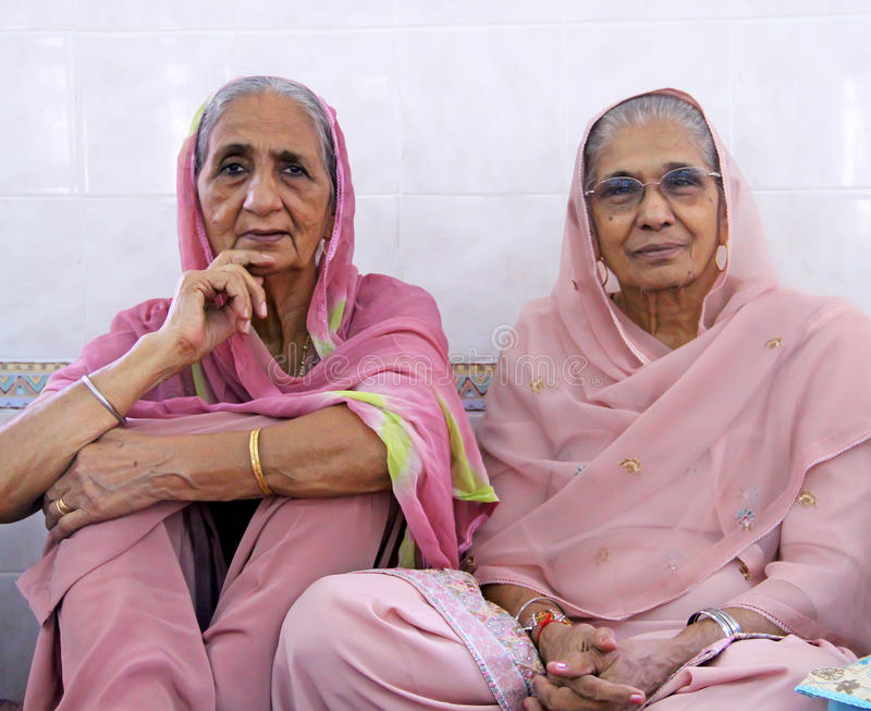 Scene at a Sikh Wedding. Elderly women at a Sikh wedding royalty free stock photo