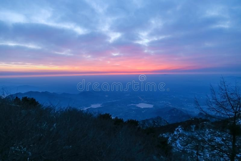 Sunrise view of mount tai. The morning glow of sunrise.Clouds surge, colorful clouds at sunrise.The sunrise on the horizon. This is the scene taken at the top stock photography
