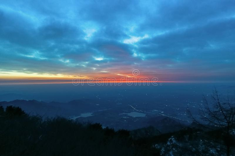 Sunrise view of mount tai. The morning glow of sunrise.Clouds surge, colorful clouds at sunrise.The sunrise on the horizon. This is the scene taken at the top royalty free stock photography