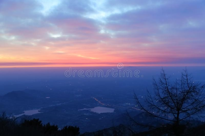 Sunrise view of mount tai. The morning glow of sunrise.Clouds surge, colorful clouds at sunrise.The sunrise on the horizon. This is the scene taken at the top stock image