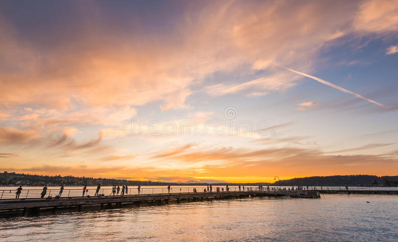 Scene of walk way on the lake when sunset in Gene Coulon Memorial Beach Park,Renton,Washington,usa. royalty free stock image