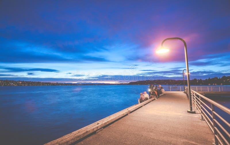 Scene of walk way on the lake when sunset in Gene Coulon Memorial Beach Park,Renton,Washington,usa.  royalty free stock image