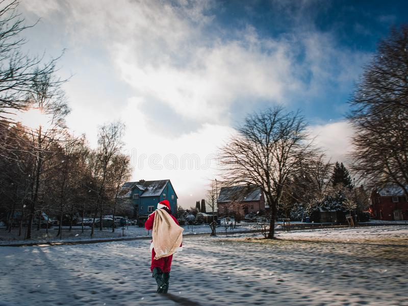 Santa Claus is coming. Winter snow-covered village in Christmas stock photography