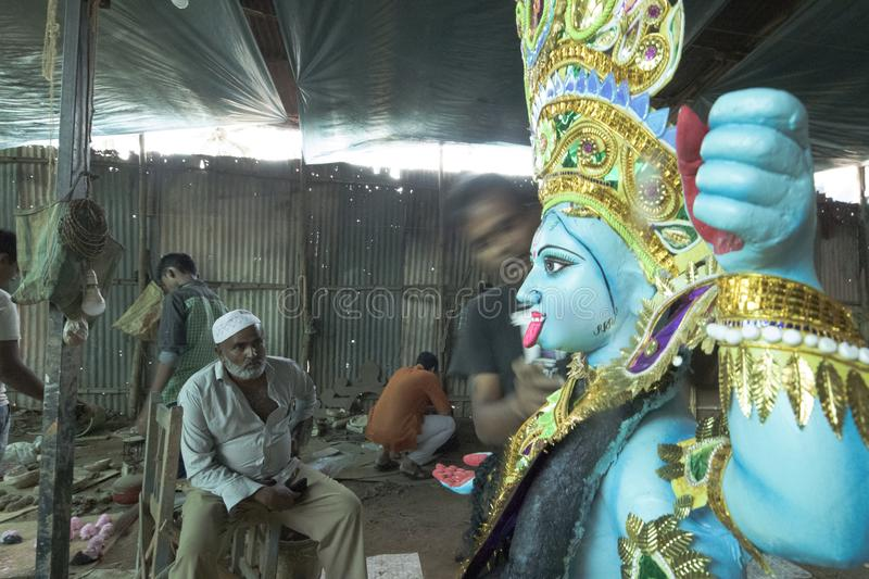 Joy of festivals has no boundaries of religion in India. A scene from a workshop where Hindu god`s idols are made. However the people there have the spirit of stock photography