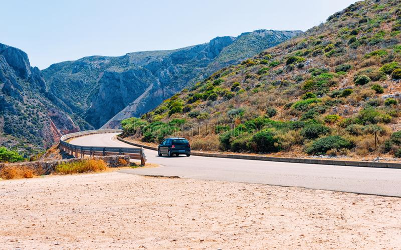 Scenery with car on highway in Cagliari in Sardinia hills royalty free stock photos