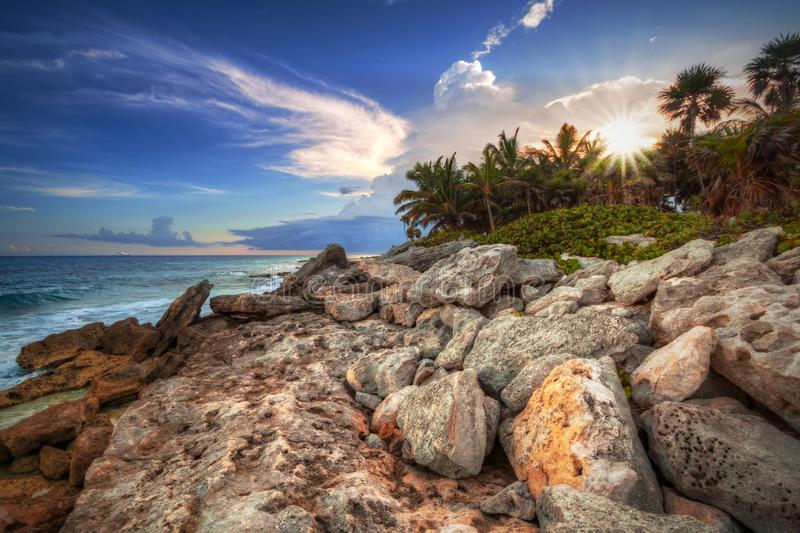 Scenery of Caribbean Sea coast near Playa del Carmen at sunset, Mexico. Beach sunlight tropical travel sunrise hdr destination sand summer paradise wave royalty free stock image