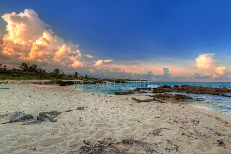 Scenery of Caribbean Sea coast near Playa del Carmen at sunset, Mexico. Beach sunlight tropical travel sunrise hdr destination sand summer paradise wave royalty free stock photos