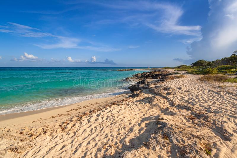 Scenery of Caribbean Sea coast near Playa del Carmen at sunset, Mexico. Beach sunlight tropical travel sunrise sunshine destination sand summer paradise wave stock image