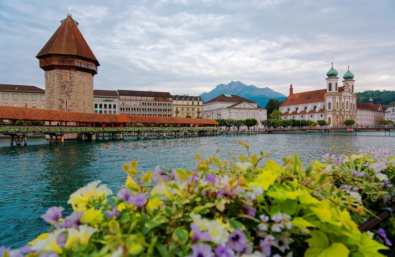Scenery of Chapel Bridge Kapellbrucke over Reuss River in Lucern, Switzerland, with Water Towe stock photo