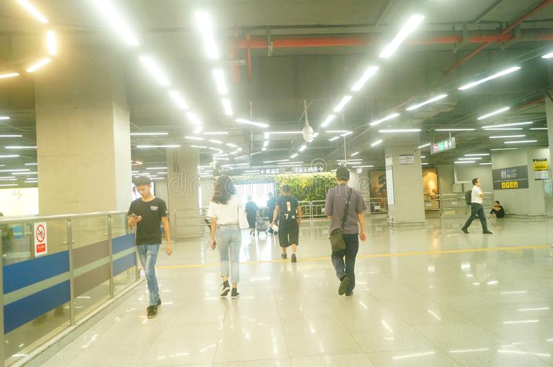 Shenzhen, China: landscape of Che Kung Temple subway station, male and female passengers. The scenery of Che Kung Miao subway station in Shenzhen, male and royalty free stock photos