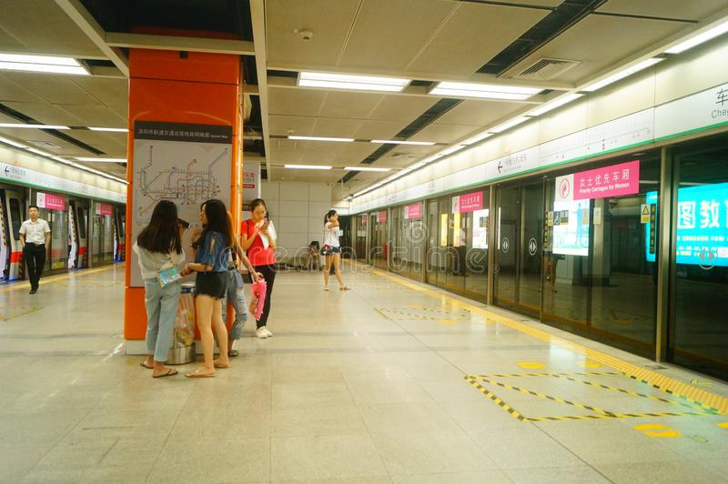 Shenzhen, China: landscape of Che Kung Temple subway station, male and female passengers. The scenery of Che Kung Miao subway station in Shenzhen, male and royalty free stock image