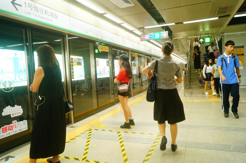 Shenzhen, China: landscape of Che Kung Temple subway station, male and female passengers. The scenery of Che Kung Miao subway station in Shenzhen, male and stock photography