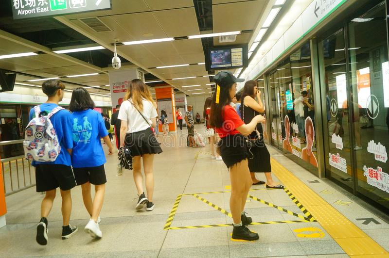 Shenzhen, China: landscape of Che Kung Temple subway station, male and female passengers. The scenery of Che Kung Miao subway station in Shenzhen, male and royalty free stock photo
