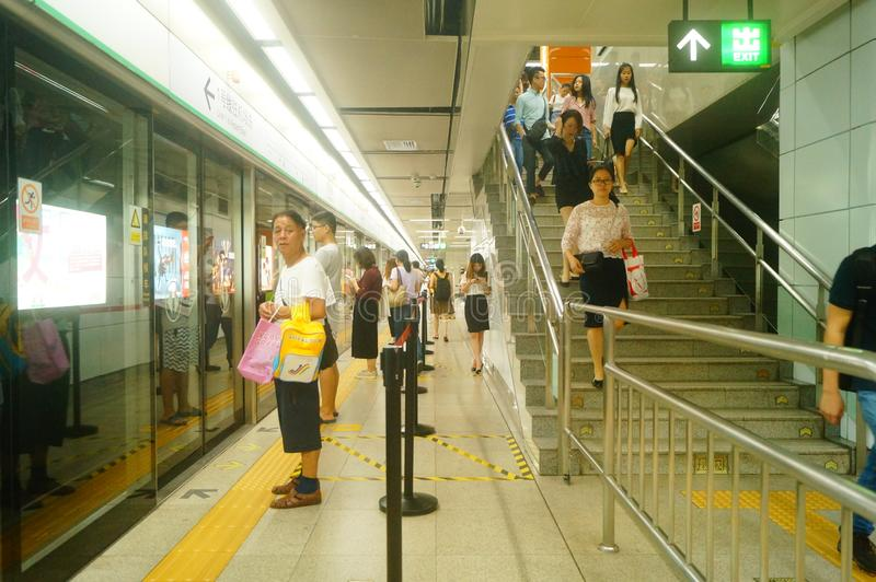 Shenzhen, China: landscape of Che Kung Temple subway station, male and female passengers. The scenery of Che Kung Miao subway station in Shenzhen, male and royalty free stock images