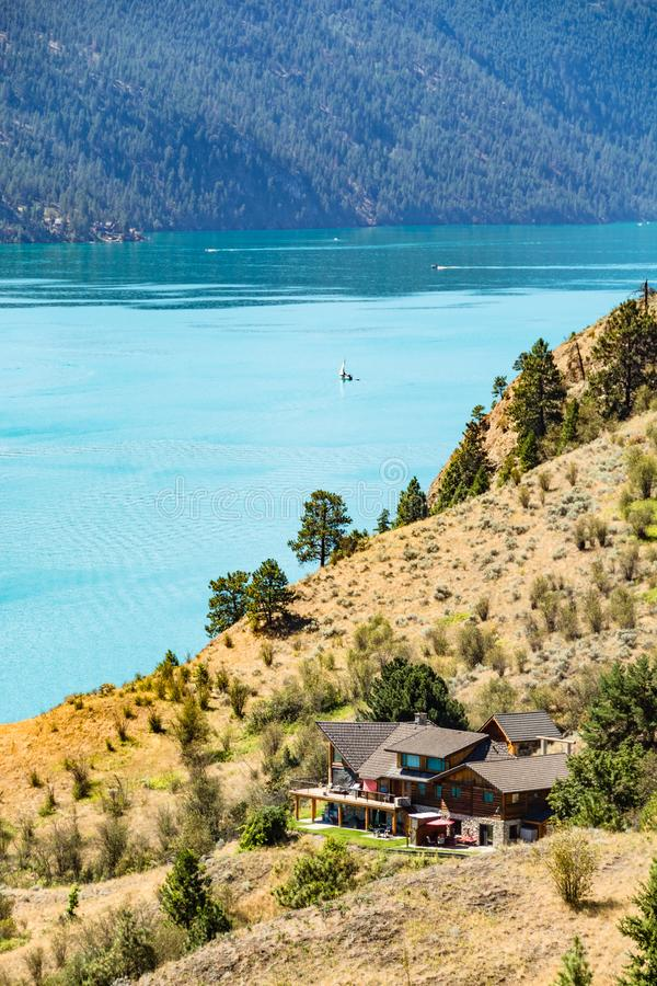 Scenery with great view on Kalamaka lake and Rocky mountain. Scenery with great view on luxury house at Kalamaka lake and Rocky mountain in British Columbia stock images