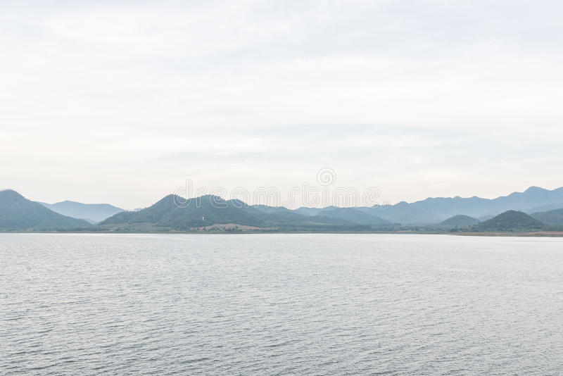Scenery of lake and mountian on cloudy day at Pranburi Dam, Prachuap Khiri Khan Province, Thailand stock images