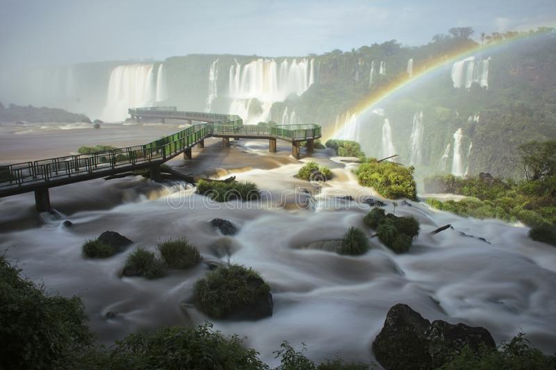 Scenery Long Exposure Photography of Iguazu Falls wit Rainbow in Brazil. This is a Photograph of a Famous Destination called Iguazu with Footbridge, Rainbow royalty free stock images