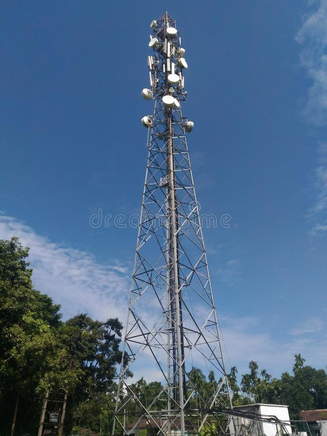 A scenery of a mobile tower with the blue sky royalty free stock photo