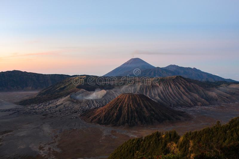 Incredible View in Bromo-Tengger-Semeru National Park. The scenery of Mount Bromo, Batok, Semeru, and sand plain made of volcanic ash in the Tengger Caldera royalty free stock images