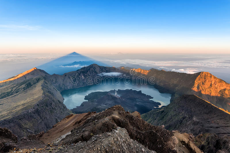 Scenery of Mount Rinjani, active volcano and crater lake from the summit at sunrise, Lombok - Indonesia.  stock photo