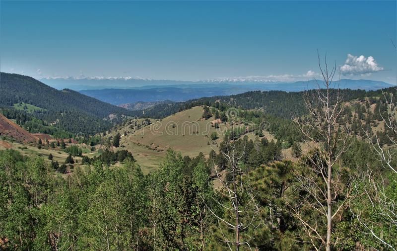 Mountains around Cripple Creek, Colorado. Scenery of the mountains just outside the small town of Cripple Creek, Colorado with snow-capped mountains in the stock image
