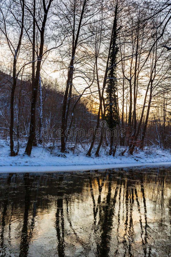 Free Scenery Of Wild River With Sunset Sky Reflection In The Mountains, In Winter Stock Photo - 91038630