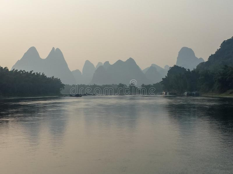 Scenery of Pearl river with hills at Guilin Guangxi China. Scenery pearl river guilin guangxi china copy space panorama water still sunset hills mountain stock image
