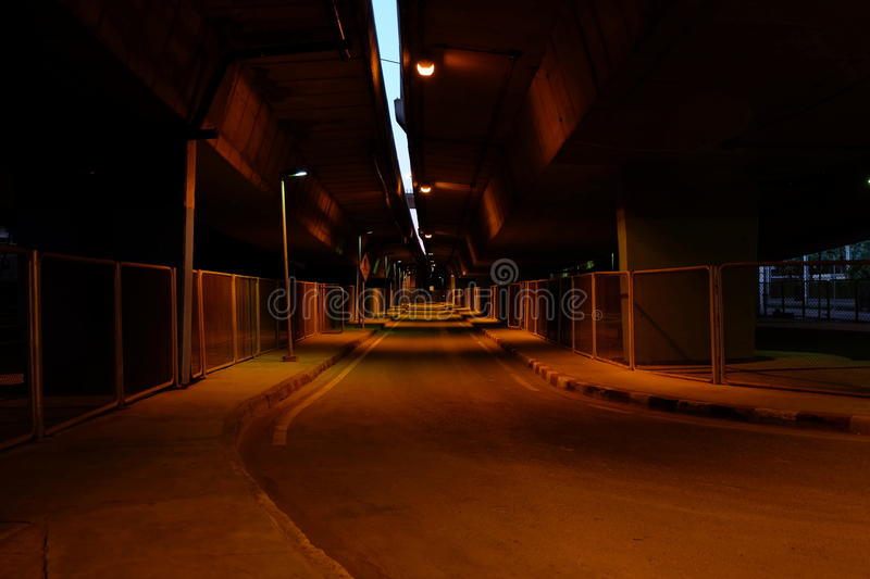 Scenery of Road Under Bridge at Night. stock photos