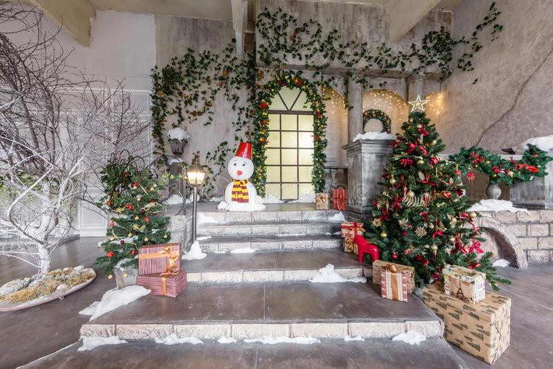 The scenery of the Studio or theater. Entrance in an old architecture with staircase and columns. Christmas decoration. With garlands and fir branches stock photography