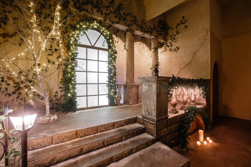 The scenery of the Studio or theater. Entrance in an old architecture with staircase and columns. Christmas decoration. With garlands and fir branches royalty free stock photos