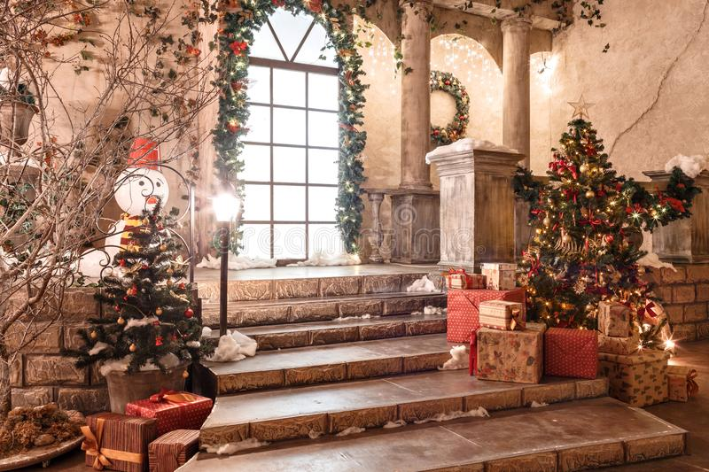 The scenery of the Studio or theater. Entrance in an old architecture with staircase and columns. Christmas decoration. With garlands and fir branches stock photo