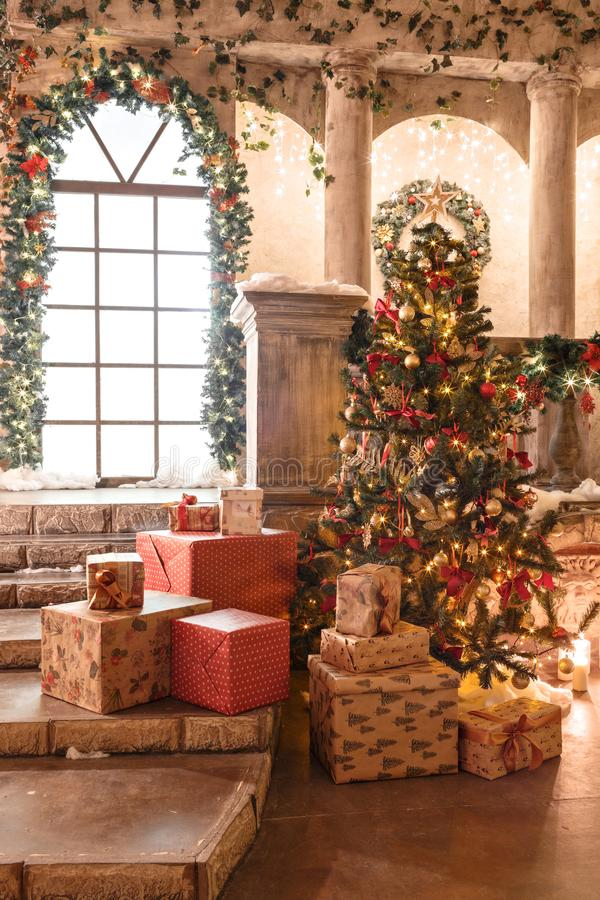 The scenery of the Studio or theater. Entrance in an old architecture with staircase and columns. Christmas decoration. With garlands and fir branches stock photos