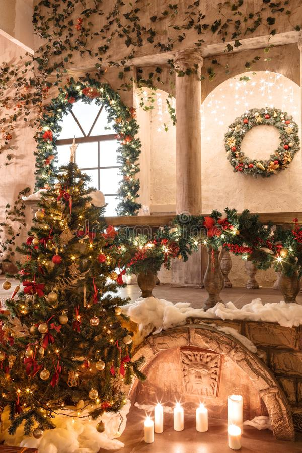 The scenery of the Studio or theater. Entrance in an old architecture with staircase and columns. Christmas decoration. With garlands and fir branches royalty free stock image
