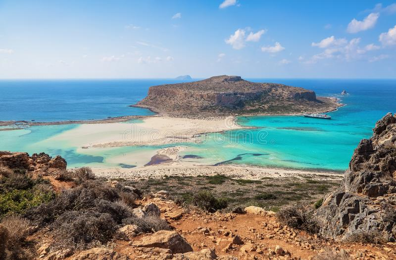 Scenery of sunny summer day with sand beach, turquoise sea and mountains. Blue horizon line. Place for tourists rest Balos lagoon stock photos