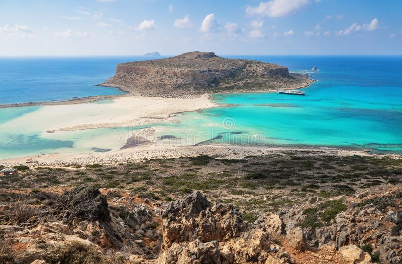 Scenery of sunny summer day with sand beach, turquoise sea and mountains. Blue horizon line. Place for tourists rest Balos lagoon. Shore of Crete island royalty free stock photo