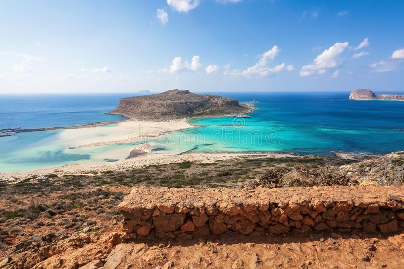 Scenery of sunny summer day with sand beach, turquoise sea and mountains. Blue horizon line. Place for tourists rest Balos lagoon. Scenery of sunny summer day stock image