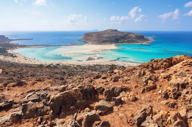 Scenery of sunny summer day with sand beach, turquoise sea and mountains. Blue horizon line. Place for tourists rest Balos lagoon. Scenery of sunny summer day royalty free stock image
