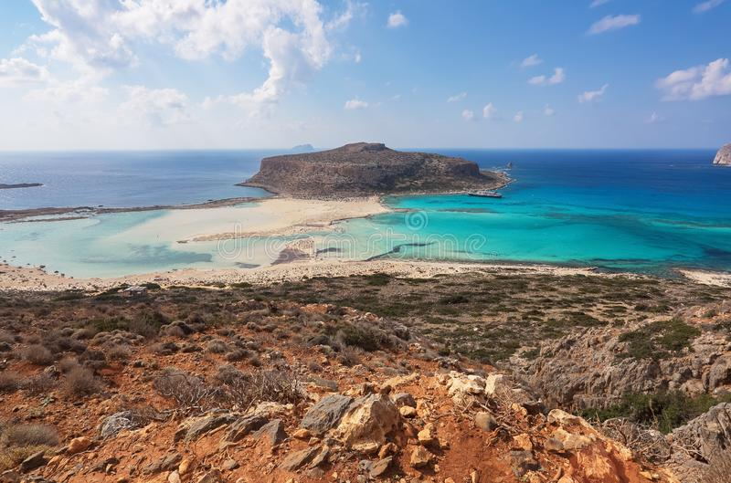 Scenery of sunny summer day with sand beach, turquoise sea and mountains. Blue horizon line. Place for tourists rest Balos lagoon. Scenery of sunny summer day stock photography