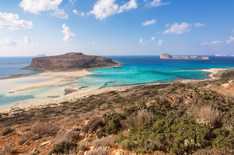 Scenery of sunny summer day with sand beach, turquoise sea and mountains. Blue horizon line. Place for tourists rest Balos lagoon. Scenery of sunny summer day royalty free stock photos