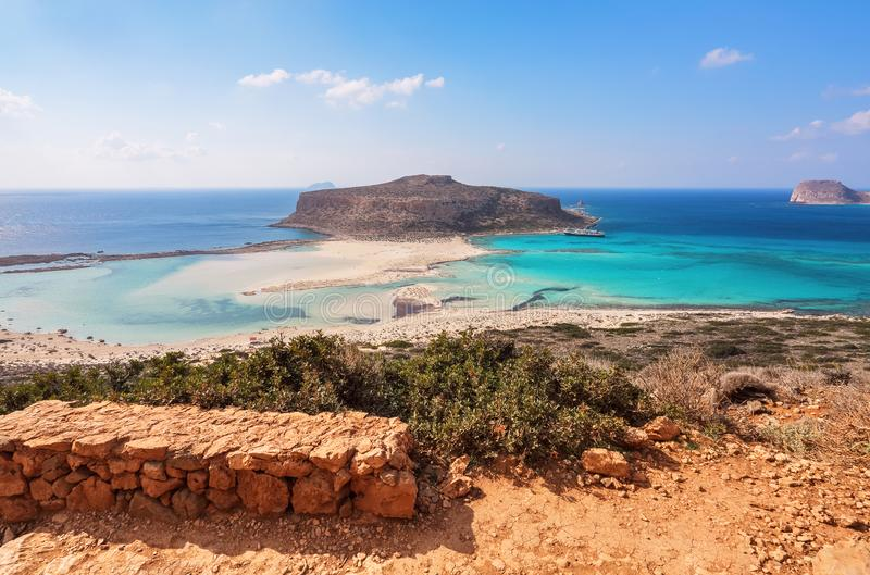 Scenery of sunny summer day with sand beach, turquoise sea and mountains. Blue horizon line. Place for tourists rest Balos lagoon. Shore of Crete island stock photos