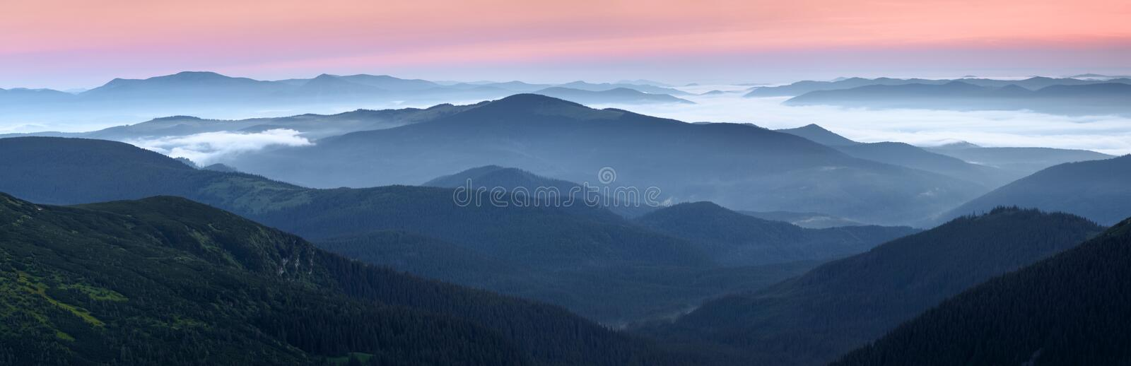 Scenery of the sunrise at the high mountains. Dense fog with beautiful light. A place to relax in the Carpathian Park. Hoverla. Scenery of the sunrise at the royalty free stock photo