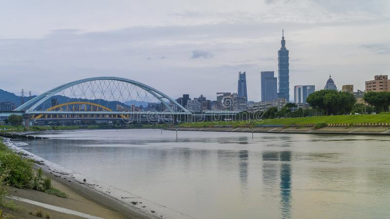 Scenery of Taipei City with beautiful reflection city skyscraper and bridge royalty free stock image